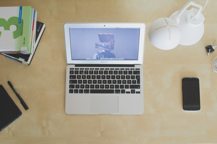 A laptop on a table to represent blogging